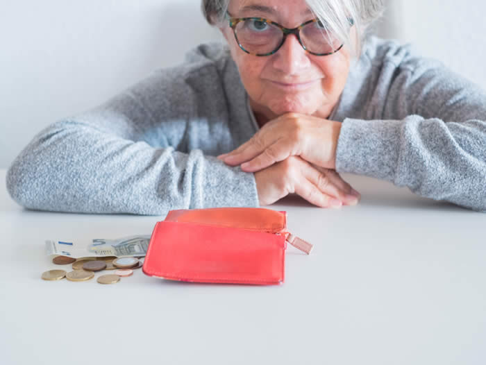 elderly woman counting her money